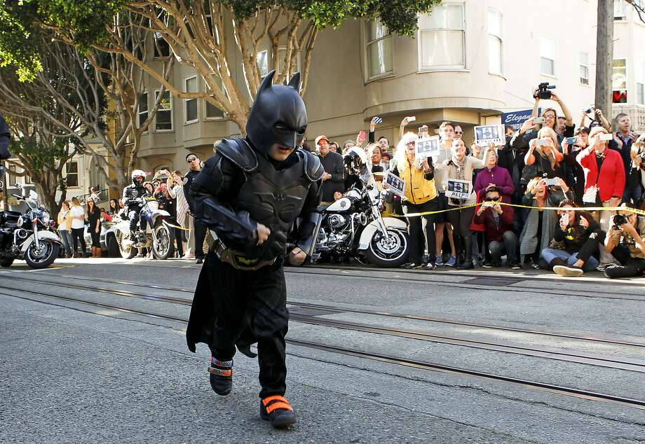 Believe it or not, it's been two years since Miles the Batkid entered our lives and made San Francisco a kinder, happier place. Here are some of our favorite pictures from that magical day. We hope it brightens your day as much as it brightened ours.  Miles as Batkid runs to the scene of a report of a damsel in distress along the Hyde Street cable car line in San Francisco Ca., on Friday Nov. 15, 2013. Photo: Michael Macor, The Chronicle