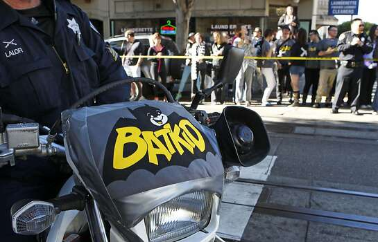 The San Francisco police lend a hand as Miles as Batkid rescues a damsel in distress along the Hyde Street cable car line in San Francisco. Photo: Michael Macor, The Chronicle