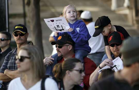 Five year old Kayla Fry and her father Daniel await the arrival of Miles as Batkid along the Hyde Street cable car line in San Francisco Ca., on Friday Nov. 15, 2013.  Five year old Miles from Tulelake in Siskiyou County loves superheroes and Batman in particular. After battling leukemia since he was a year old Miles will fulfill his dream of becoming Batkid being swept around the city performing superhero feats from rescuing a damsel in distress to thwarting a bank robbery and even chasing down the Penguin through AT&T Park Photo: Michael Macor, The Chronicle