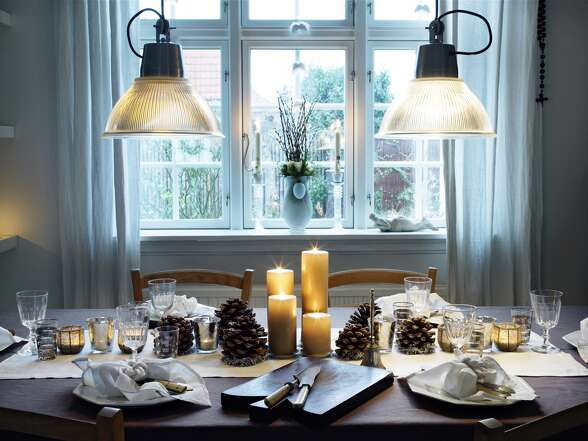 "Holiday go lightly    ""Avoid the tendency to over-clutter with more than you need. I love a winter palette of whites and neutrals with accents of gold and silver, and fresh greens for texture. Layer white dinner plates with a few special pieces like scalloped salad plates, linen napkins and gold flatware. Fill mint julep cups with bunches of rosemary and mint, and scatter these among lots of low mercury-glass votives down the table.""    Lauren Nelson, interior designer and prop stylist,  www.laurennelsondesign.com"
