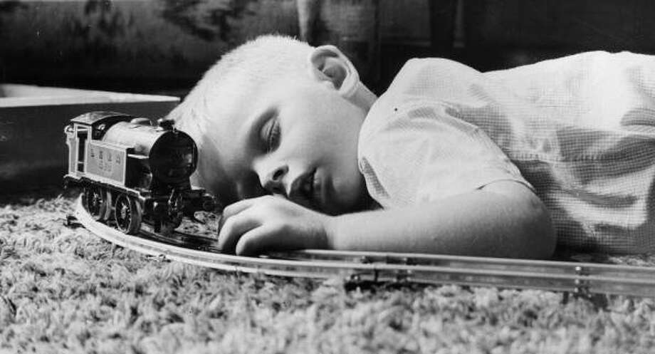 Toy Trains:Even this kid from 1937 is bored to death of toy trains. Photo: B. C. Parade, Getty Images / Hulton Archive