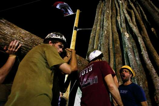 "Students from Texas A&M University work to build the traditional ""Aggie Bonfire"" off-campus Nov. 9, 2009, in College Station.  Photo: Michael Paulsen, Houston Chronicle / Houston Chronicle"