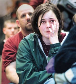 Texas A&M junior Wendy Alexander wipes a tear after hearing A&M president Ray Bowen announce that there will not be a school bonfire for 2002. .  Photo: DAVE MCDERMAND, AP / BRYAN EAGLE