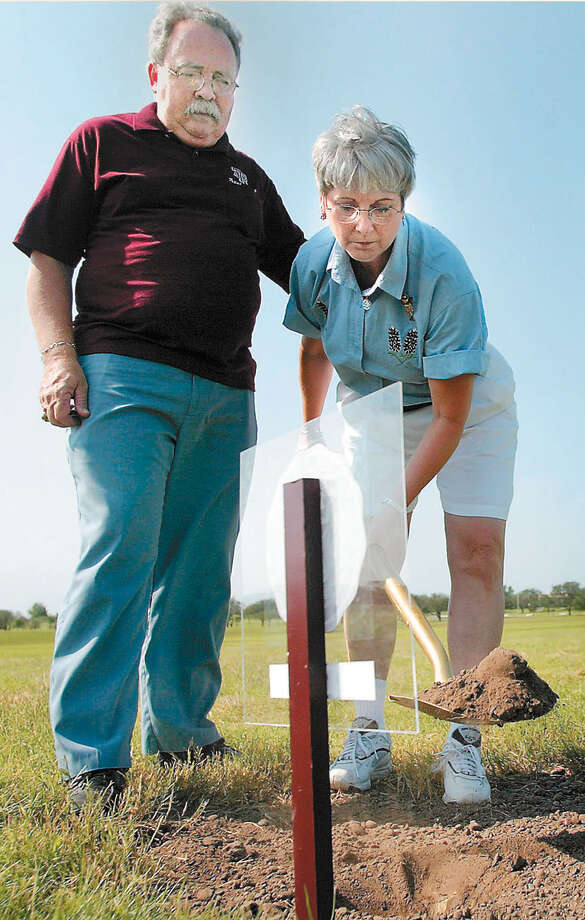 Tim and Janice Kerlee break ground on behalf of their son, Tim Kerlee Jr., who was killed in the collapse of the Texas A&M Bonfire in 1999, at a groundbreaking ceremony for the Texas A&M Bonfire Memorial, July 19, 2003, in College Station. Photo: PATRIC SCHNEIDER, AP / BRYAN EAGLE