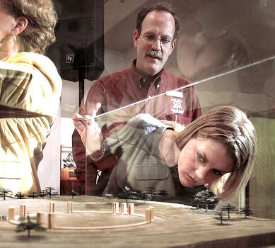 Texas A&M University sophomore Kristin West looks at a model of the winning design for the Bonfire Memorial with her father Richard Allen West, of Bellaire, March 6, 2002, in College Station. Richard West was a member of the jury that voted the winning design. His son was one of the 12 Aggies who died in the 1999 Bonfire collapse.  Photo: BUTCH IRELAND, AP / BRYAN-COLLEGE STATION EAGLE