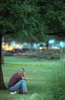A Texas A&M student sits on his hardhat while visiting the site of a bonfire collapse, Nov. 19, 1999, in College Station. Photo: Smiley N. Pool, Houston Chronicle / Houston Chronicle