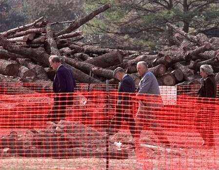 Texas A&M officials lead members of the Special Commission on the 1999 Bonfire chairman Leo Linbeck Jr., second from right, and Veronica Kastrin Callaghan tour the site of the collapse .Dec. 3, 1999, in College Station. Photo: PAT SULLIVAN, AP / AP