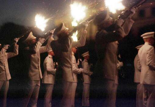 Ross Volunteers fire off the third round of a 21-gun salute during the Silver Taps ceremony in front of the Academic Building at Texas A&M University in College Station on Dec. 7, 1999.  The volunteers and students gathered at the plaza to honor the students who were killed in the Nov. 18 bonfire collapse. Photo: JP BEATO, AP / THE BATTALION