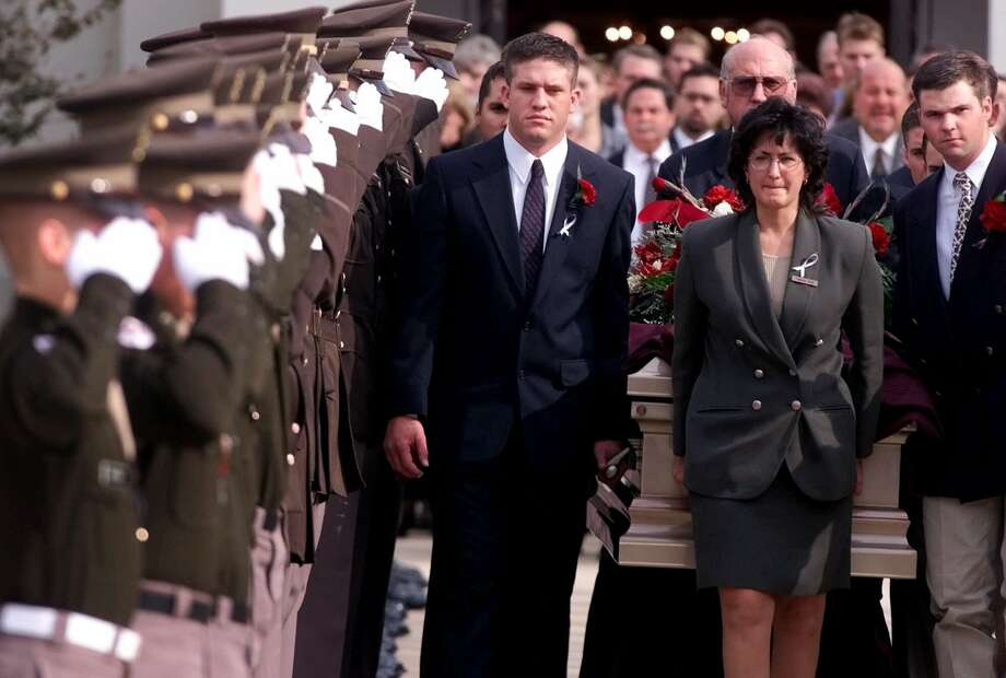 Texas A&M Corp of Cadets, serving as honorary pallbearers, salute the casket of fellow student Bryan McClain at the Alamo Heights United Methodist church in San Antonio on Nov. 22, 1999.  Photo: ERIC GAY, AP / AP