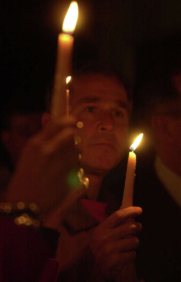 Texas Gov. George W. Bush  on the Texas A&M campus for a candlelight vigil Nov. 25, 1999 at the site where 12  died in the bonfire collapse. (Smiley N. Pool/Chronicle) Photo: SMILEY N. POOL, Houston Chronicle / Houston Chronicle