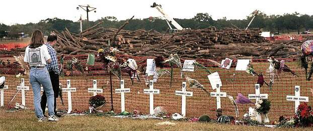 Mourners visit the site where 12 people were killed by the collapse of a bonfire tower of logs Nov. 22, 1999, on the campus of Texas A&M University in College Station Photo: DAVE MCDERMAND, AP / BRYAN EAGLE