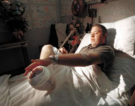 Texas A&M freshman Lanny Hayes points to his crushed foot during an interview at St. Joseph Regional Health Center Nov. 20, 1999 in Bryan.  Hayes was on the first stack of the bonfire when it collapsed. Photo: BUTCH IRELAND, AP / BRYAN COLLEGE STATION EAGLE