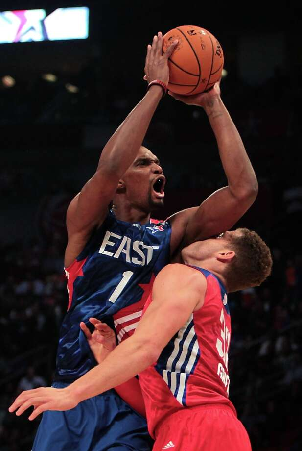 Chris Bosh of the Miami Heat (1) drives over Blake Griffin of the Los Angeles Clippers (32) during the first half. Photo: James Nielsen, Chronicle / © 2013  Houston Chronicle