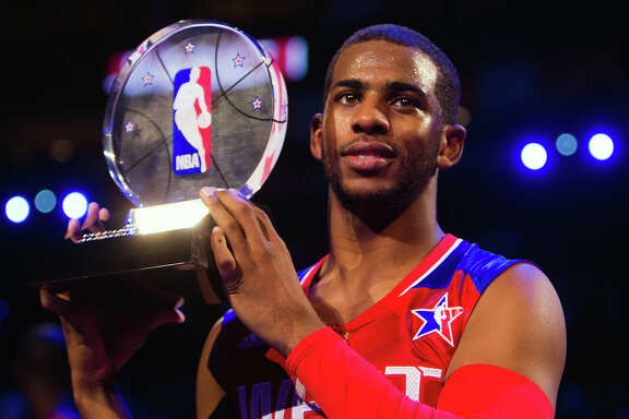 Chris Paul of the Los Angeles Clippers celebrates with the game MVP trophy.