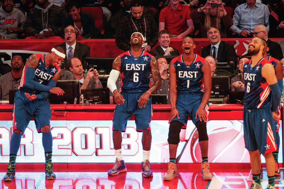 Carmelo Anthony of the New York Knicks (7), LeBron James of the Miami Heat (6), Chris Bosh of the Miami Heat (1) and Tyson Chandler of the New York Knicks (6) laugh as the watch the video screen. Photo: Billy Smith II, Houston Chronicle / © 2013  Houston Chronicle