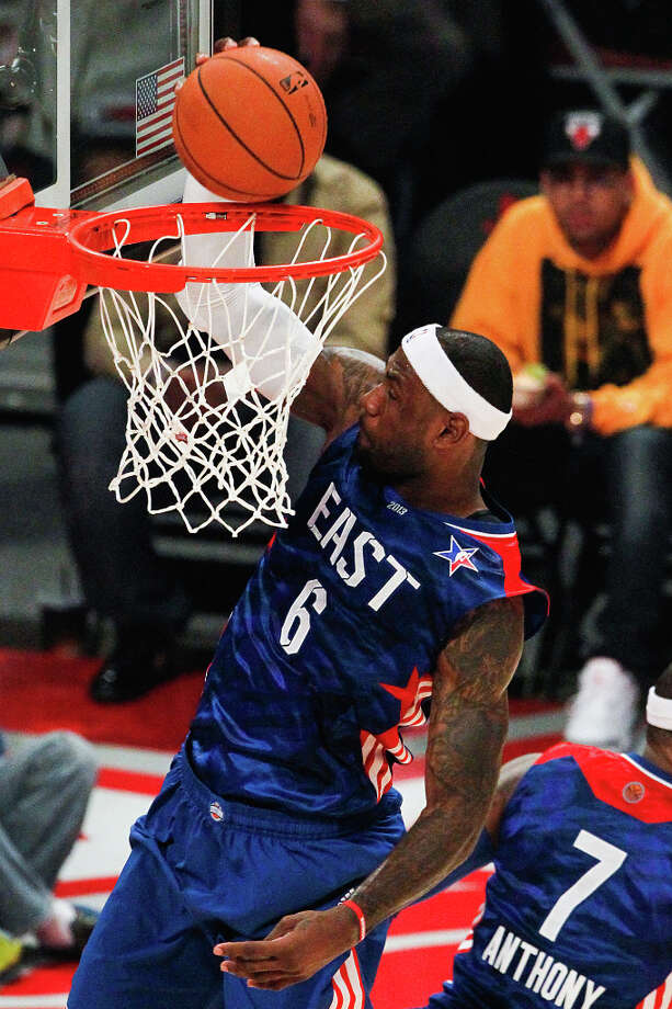 LeBron James of the Miami Heat (6) goes up for a dunk during the first half. Photo: Cody Duty, Houston Chronicle / © 2013  Houston Chronicle