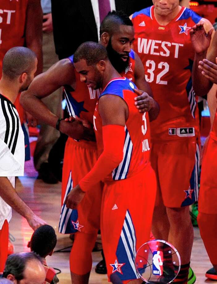 James Harden congratulates Chris Paul on winning the game's MVP award. Photo: Billy Smith II, Chronicle / © 2013  Houston Chronicle