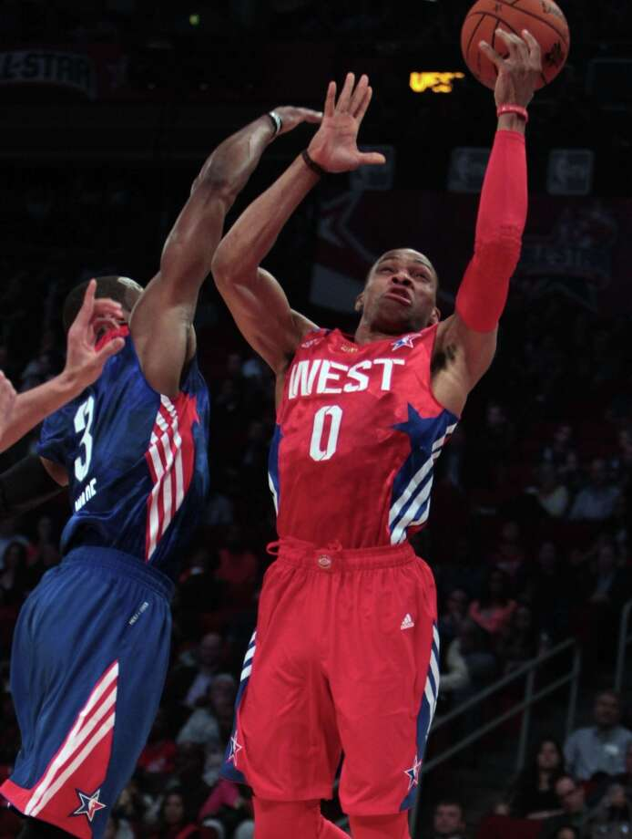 Russell Westbrook of the Oklahoma City Thunder (0) goes to the basket against Dwyane Wade of the Miami Heat (3) during the second half. Photo: James Nielsen, Chronicle / © 2013  Houston Chronicle