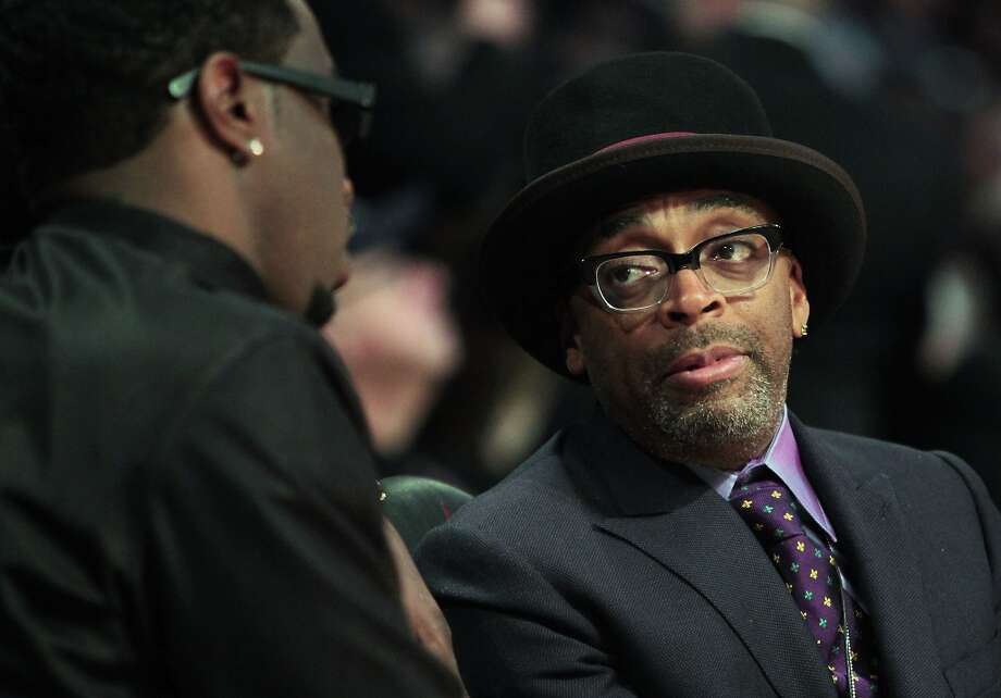 Spike Lee chats with Sean Combs during the first half of the NBA All-Star Game at the Toyota Center on Sunday, Feb. 17, 2013, in Houston. ( James Nielsen / Houston Chronicle ) Photo: James Nielsen, Chronicle / © 2013  Houston Chronicle