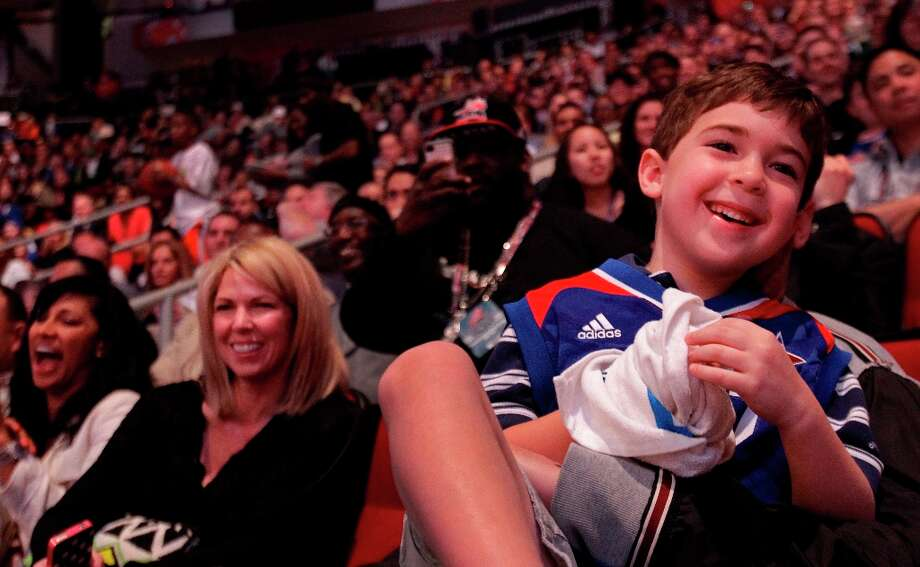 Ethan Robins, 6, of Bellaire laughs during a skit performed at a break in the action at the NBA All-Star Game at the Toyota Center on Sunday, Feb. 17, 2013, in Houston. ( Melissa Phillip / Houston Chronicle ) Photo: Melissa Phillip, Chronicle / © 2013  Houston Chronicle