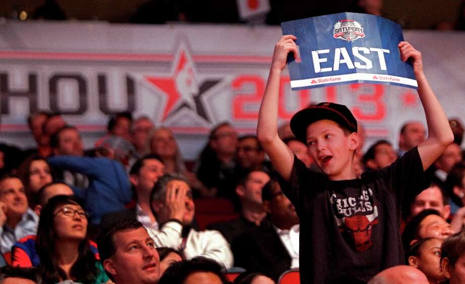 Nathan Cupps, 11, of Plainfield, IL cheers on the East Team during the second half of the NBA All-Star Game at the Toyota Center on Sunday, Feb. 17, 2013, in Houston. ( Melissa Phillip / Houston Chronicle ) Photo: Melissa Phillip, Chronicle / © 2013  Houston Chronicle