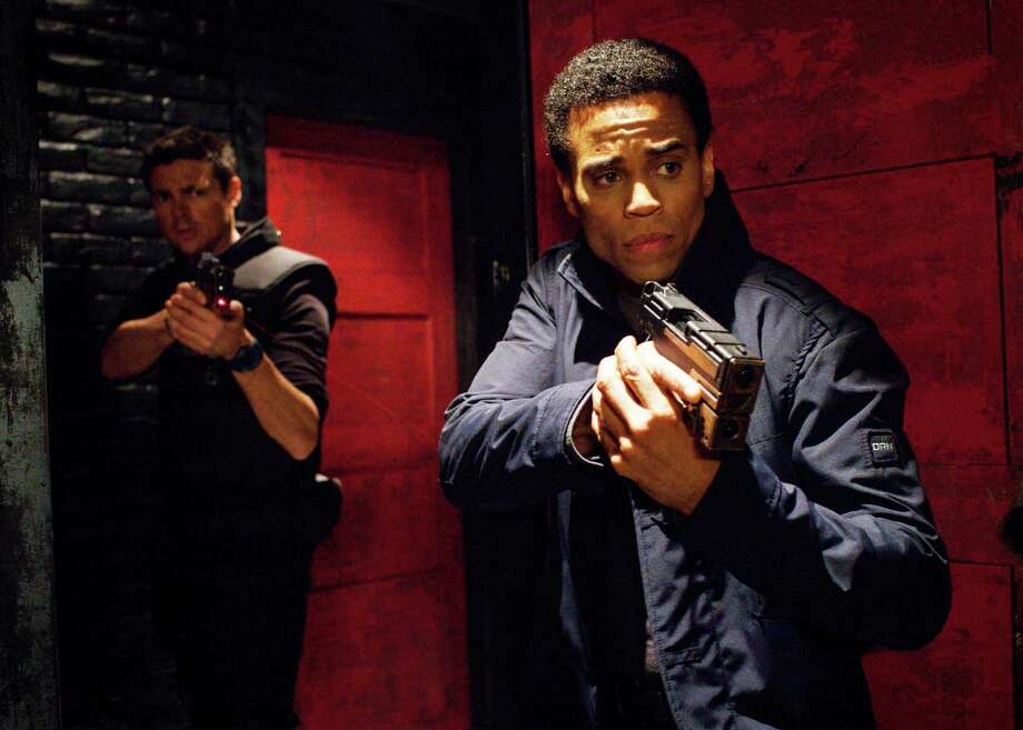 "ALMOST HUMAN: Det. John Kennex (Karl Urban, L) and Dorian (Michael Ealy, R) are dispatched to investigate a murder and high-profile missing persons case in ""Skin,"" the Series Premiere, Night Two, episode of ALMOST HUMAN, airing Monday Nov. 18  (8:00-9:00 PM ET/PT) on FOX. ©2013 Fox Broadcasting Co. Cr: Liane Hentscher/FOX / 1"