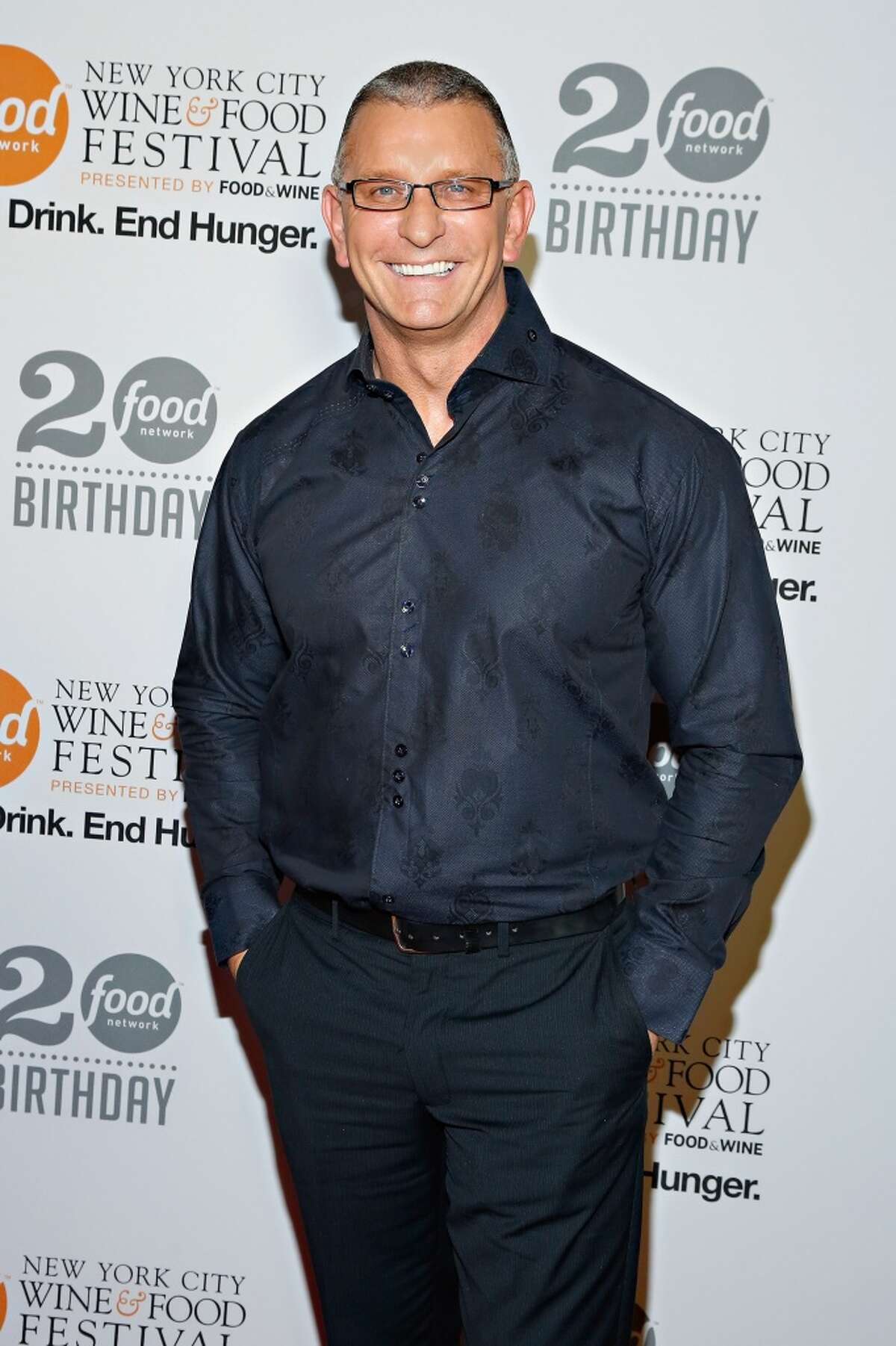Robert Irvine attends Food Network's 20th birthday celebration at Pier 92 on Oct. 17, 2013 in New York City. He will present his live stage show at the Ridgefield Playhouse in Ridgefield, Conn., on Nov. 17, 2013. (Photo by Cindy Ord/Getty Images)