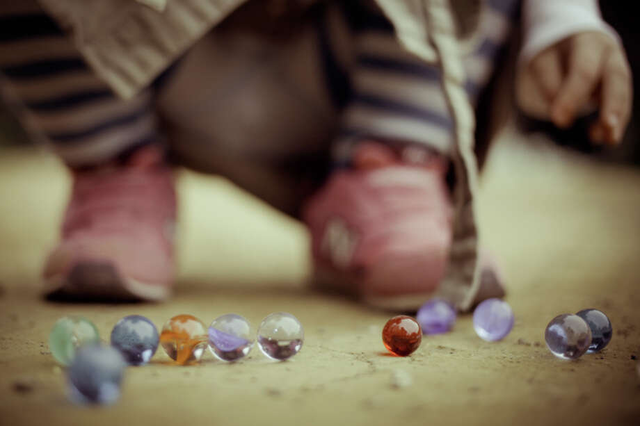 Marbles:Just give your kids a sack of rocks and save the 84 cents, big spender. Photo: Jonathan Puntervold, Getty Images/Flickr RF / Flickr RF