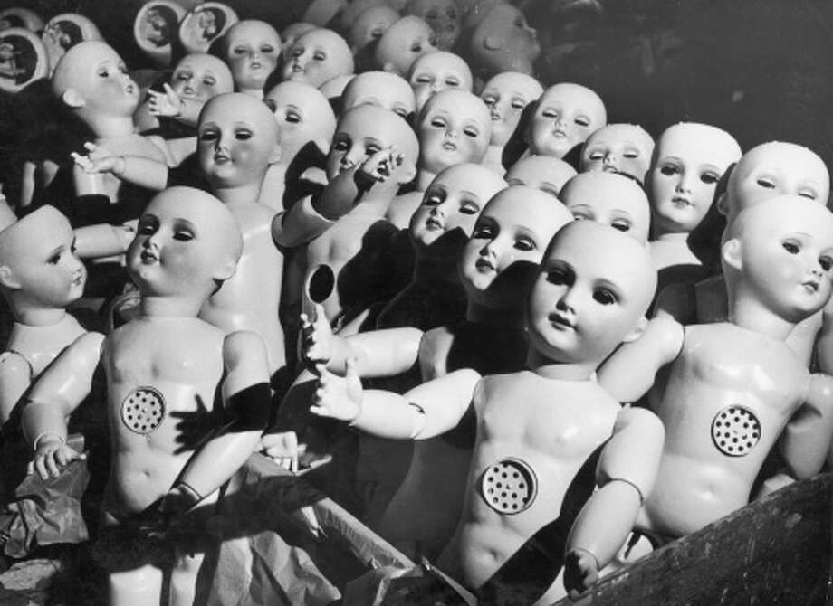 Creepy Dolls:Fact: Every doll made before 1982 was creepy. These dolls, seen here still on the assembly line, will haunt your dreams. Photo: Keystone-France, Getty Images / (c) Keystone-France