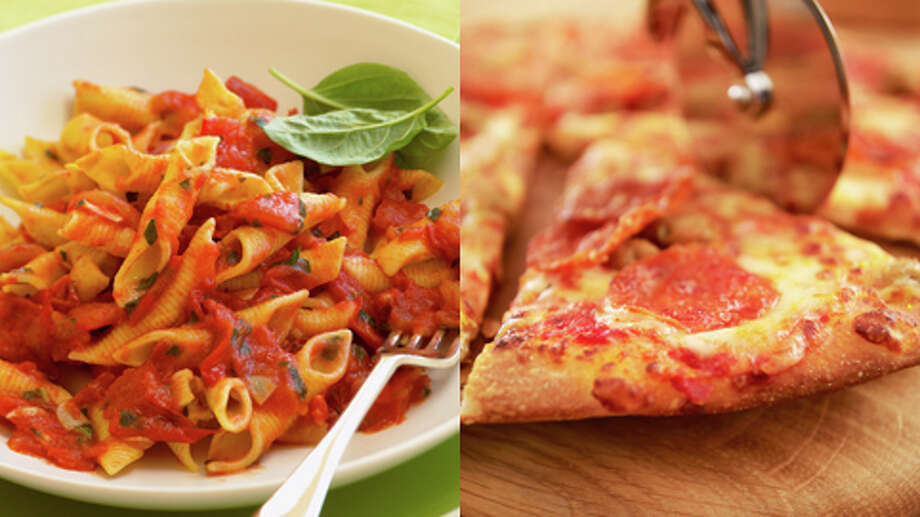 Pizza or Pasta?  That's a tough one.  Both are loaded with calories, carbs, sodium, and more. But at least with pasta, you can dodge the saturated fat...if you're careful and order a pasta dish with no cream, cheese or meat. Photo: Getty Creative Stock