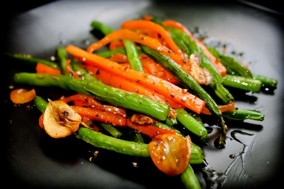 Tip   Ask for a side dish of vegetables instead of rice or noodles. The sodium (about 500 mg) isn't low, but the veggies have fewer calories (about 100) than the rice or noodles (300 to 400). And the vegetables' potassium may counter the load of sodium in the rest of your Asian food. Photo: Iris Filson, Getty Images/Flickr RF