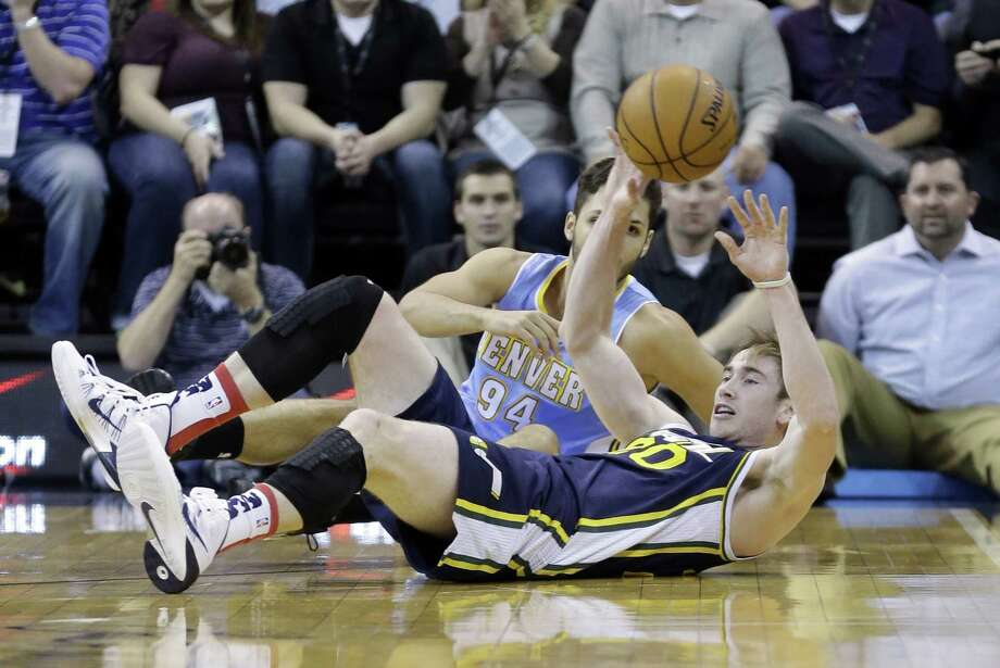 Utah Jazz's Gordon Hayward (20) passes the ball as Denver Nuggets' Evan Fournier (94) looks on in the first quarter during an NBA basketball game Monday, Nov. 11, 2013, in Salt Lake City.  (AP Photo/Rick Bowmer) Photo: Rick Bowmer, Associated Press / AP