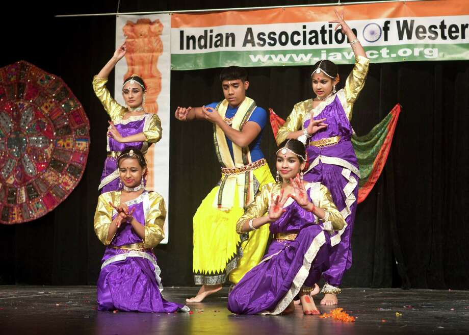 Young dancers with The Indian Association of Western Connecticut (IAWCT) celebrate the Festival of Lights, also known as Diwali, during a program with dinner, music and more at Newtown High School last Saturday, Nov. 9. Diwali is a five-day festival. Photo: Contributed Photo / The News-Times Contributed