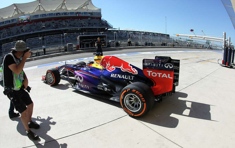 Current World Champion Sebastian Vettel exits the garage for the Formula One United States Grand Prix afternoon practice session at the Circuit of the Americas near Austin, Texas on Friday, Nov. 15, 2013. Photo: Kin Man Hui, San Antonio Express-News / ©2013 San Antonio Express-News