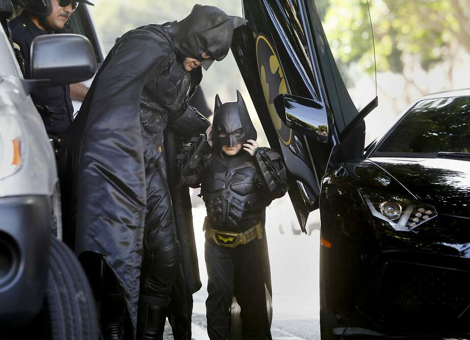 Batman and Miles Scott as Batkid arrive on the scene of a report of a damsel in distress along the Hyde Street cable car line in San Francisco on Friday Nov. 15, 2013. Photo: Michael Macor, The Chronicle