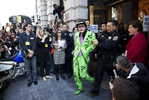 San Francisco police officers arrest the Riddler with the help of 5-year-old leukemia survivor Miles Scott, also known as BatKid November 15, 2013 in San Francisco. Make-A-Wish Greater Bay Area foundation turned the city into Gotham City for Miles by creating a day long event bringing his wish to be a BatKid to life. Photo: Ramin Talaie, Getty Images