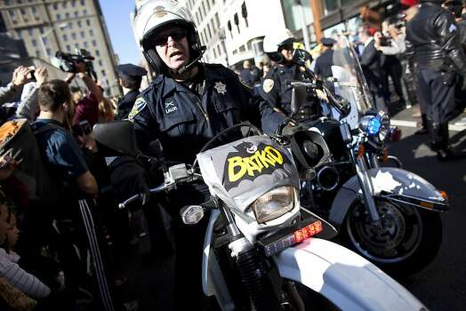 Police escorts 5-year-old leukemia survivor Miles, also known as BatKid as he exits his cave at Union Square November 15, 2013 in San Francisco. Make-A-Wish Greater Bay Area foundation turned the city into Gotham City for Miles by creating a day long event bringing his wish to be a BatKid to life. Photo: Ramin Talaie, Getty Images
