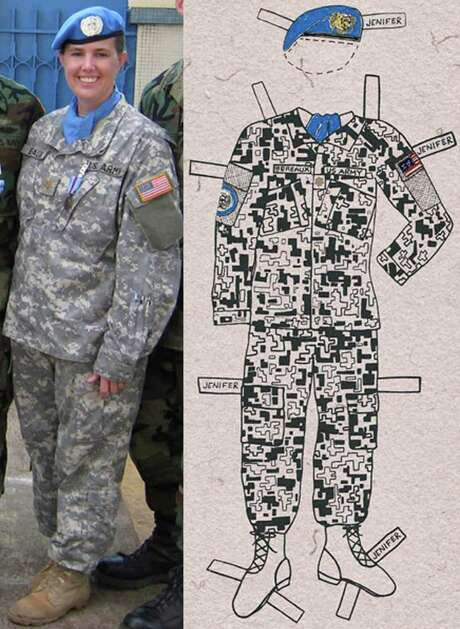 Dozens of women donated uniforms and accessories for Pam DeLuco's project that tells the story of women in the military through paper dolls. Photo: New York Times News Service, HO / ONLINE_YES