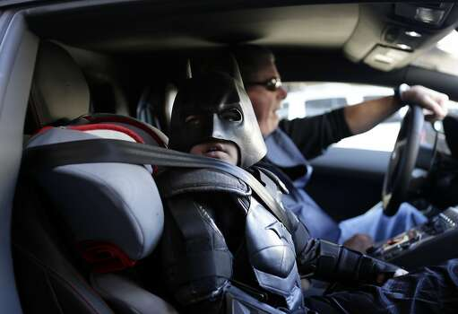 "Miles Scott, 5, dressed as Batkid, waits in a Lamborghini ""Batmobile"" as he and Batman get ready to stop a bank robbery in San Francisco, Friday, Nov. 15, 2013. San Francisco turned into Gotham City on Friday, as city officials helped fulfill Scott's wish to be ""Batkid."" Photo: Gary Reyes, Associated Press"