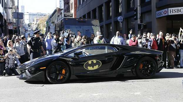 The crowd cheers as Miles Scott, 5, dressed as Batkid, as he rides inside the Batmobile in San Francisco on Friday, Nov. 15, 2013. Photo: Gary Reyes, Associated Press