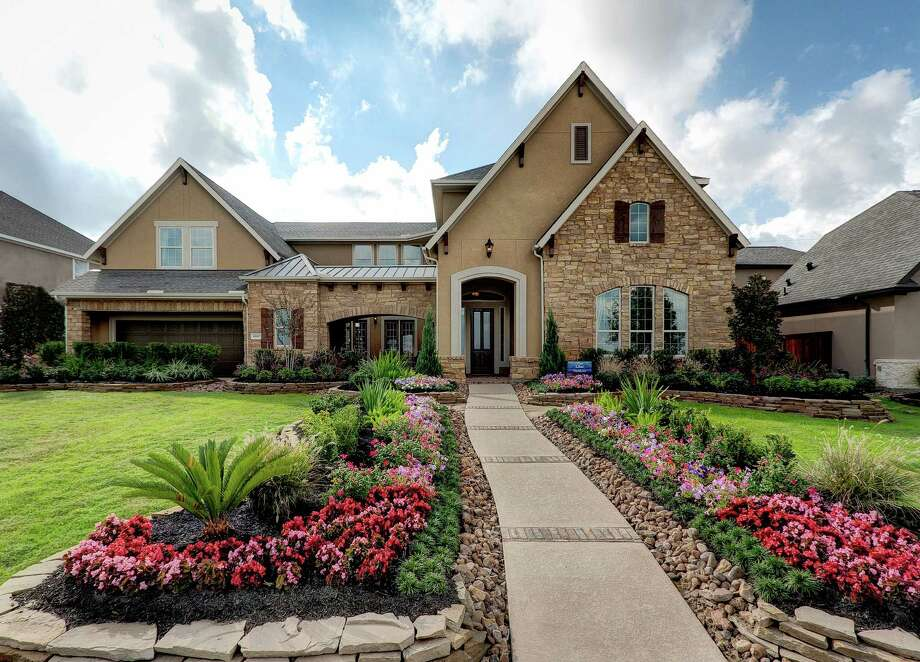 David Weekley Homes offers a variety of one- and two-story plans in the Cy-Fair community of Towne Lake. The Lilac, shown, is Weekley's model home for the community. / 2011 Connie Anderson Photography