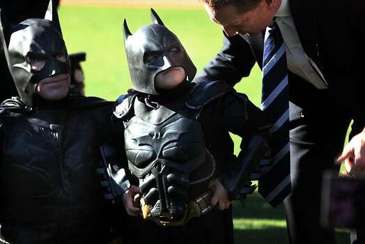 Batkid fights crime at AT&T park  in San Francisco. Photo: Liz Hafalia, The Chronicle