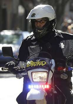 A San Francisco Police Officer with a Batkid sign on his bike waits for the arrival of Miles Scott, dressed as Batkid, in San Francisco, Friday, Nov. 15, 2013. Photo: Jeff Chiu, Associated Press