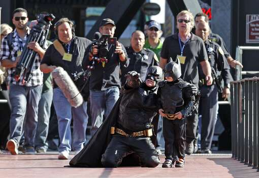 Batman and Batkid work on a plan to capture The Penguin who has kidnapped SF Giants mascot Lou Seal at AT&T Park in San Francisco Ca., on Friday Nov. 15, 2013. Photo: Michael Macor, The Chronicle