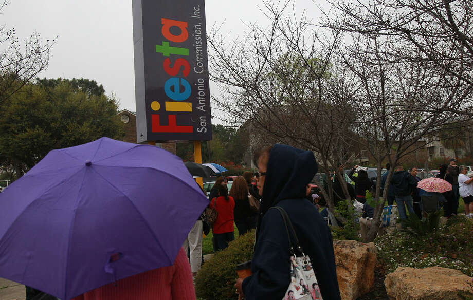 People lined up last spring at The Fiesta Store to purchase tickets for Fiesta events. The festival helps define San Antonio. Photo: Express-News File Photo