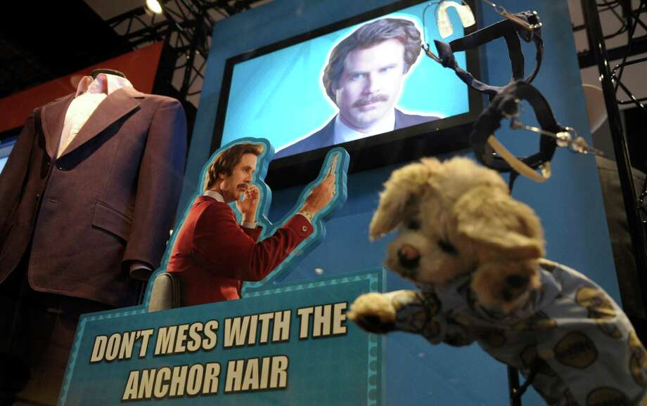 "Props and costumes from the ""Anchorman"" movie are seen at an exhibit at the Newseum in Washington, Friday, Nov. 15, 2013. The museum about news and the First Amendment has opened ""Anchorman: The Exhibit,"" featuring costumes and props from Will Ferrell's 2004 movie ""Anchorman: The Legend of Ron Burgundy."" The story of a fictional news team's sexist reaction to the arrival of an ambitious female reporter was a parody of real tumult in the 1970s TV business. (AP Photo/Susan Walsh) ORG XMIT: DCSW103 Photo: Susan Walsh / AP"