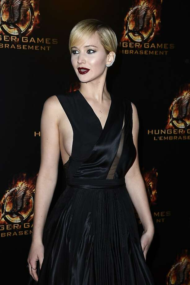 """Short and sweet:At the """"The Hunger Games: Catching Fire"""" premiere in Paris, a glamorous Jennifer Lawrence rocks her new pixie cut. Photo: Pascal Le Segretain, Getty Images"""