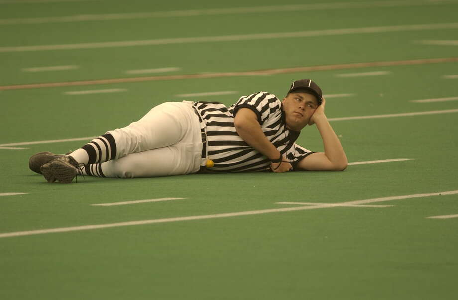 """Some extras in """"Friday Night Lights"""" developed skin rashes from exposure to the old AstroTurf while filming in the Astrodome in 2004, a reader reports. Photo: Carlos Antonio Rios, Staff / Houston Chronicle"""