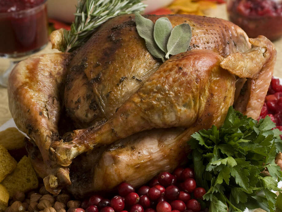 The average Turkey Day dinner will cost $49.04, or just 44 cents less in 2013 than it did in 2012. Photo: Larry Crowe, FRE / FR41490 AP
