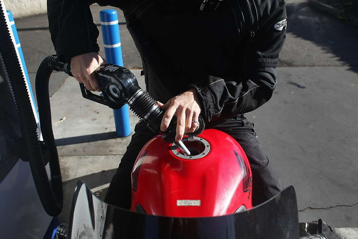Marcel Bouma fills his motorcycle with gasoline at Twin Peaks Auto Care on November 15, 2013 in San Francisco, Calif.